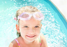 Cute little girl in swimming pool in glasses Royalty Free Stock Images