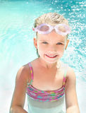 Cute little girl in swimming pool in glasses Stock Photography