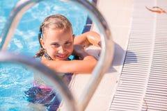 Cute little girl in swimming pool Stock Photo