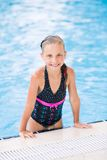 Cute little girl in swimming pool Stock Image