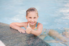 Cute little girl in swimming pool Royalty Free Stock Images