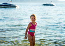 Cute little girl swimming in the sea with water wing. Childhood concept Royalty Free Stock Photos
