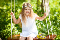 Cute little girl on the swing. Cute funny little girl on the swing Stock Photography