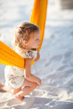 Cute little girl swinging in hammock. At tropical beach Stock Images