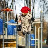 Cute little girl swinging on seesaw. On children payground Royalty Free Stock Images