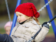 Cute little girl swinging on seesaw. On children payground Stock Images