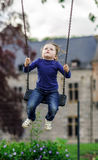 Cute little girl swinging on seesaw. To the sky Stock Image