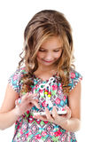 Cute little girl with tablet pc isolated on a white Stock Photo