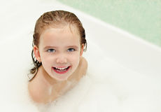 Cute little girl is taking a bath Royalty Free Stock Photos