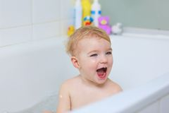 Cute little girl taking bath Royalty Free Stock Photos