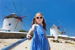 Cute little girl taking selfie Royalty Free Stock Photos