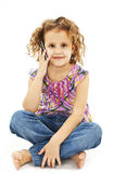 Cute little girl is talking on cell phone Royalty Free Stock Photography