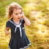 Cute little girl talking. On the phone stock photos