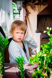 cute little girl talking on the phone. Child with mobile , angry, serious. Looking at the camera. Royalty Free Stock Images