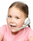 Cute little girl is talking to customers Stock Photos