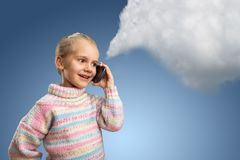 Cute little girl talks on phone Stock Images