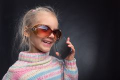 Cute little girl talks on phone Royalty Free Stock Photo