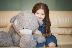 Cute little girl with teddy bear Stock Images