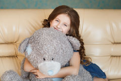 Cute little girl with teddy bear Royalty Free Stock Images