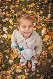 Cute little girl teddy bear in hand. Selective focus on face Stock Photography