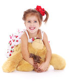 Cute little girl with a teddy bear Royalty Free Stock Photography
