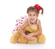 Cute little girl with a teddy bear Royalty Free Stock Image