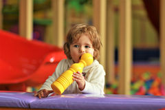 Cute little girl teething on a toy Stock Photography