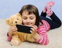 Cute little girl with telephone Stock Photos