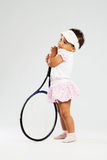 Cute little girl with tennis racket Royalty Free Stock Image