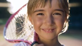 Cute little girl looking to the camera and smiling. stock footage