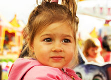 Cute little girl thinking at the park Royalty Free Stock Images