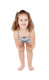 Cute little girl with three year old crouching Stock Images