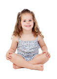 Cute little girl with three year old sitting on the floor Stock Images
