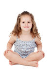 Cute little girl with three year old sitting on the floor Stock Image