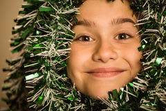 Cute little girl with tinsel around her head Stock Photography