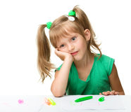 Cute little girl is tired with drawing Royalty Free Stock Image