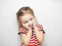Cute little girl with touched facial expression portrait royalty free stock photos