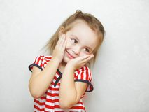 Cute little girl with touched facial expression portrait royalty free stock photography