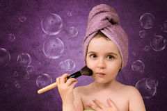 Cute little girl in a towels after bath Royalty Free Stock Photo