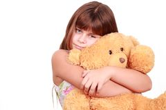 Cute little girl with toy bear Stock Photo