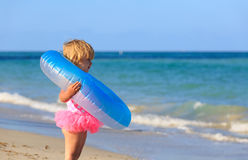 Cute little girl with toy floating ring at beach Royalty Free Stock Photos