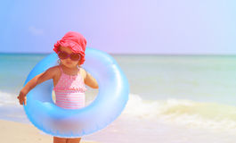 Cute little girl with toy floating ring at beach Royalty Free Stock Photo