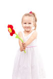 Cute little girl with toy flower isolated Royalty Free Stock Photography