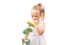 Cute little girl with toy flower isolated Stock Photo
