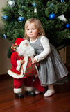 Cute little girl with toy Santa Claus Royalty Free Stock Images