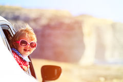 Cute little girl travel by car in mountains Stock Images