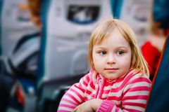 Cute little girl travel by plane, family in flight. Transportation royalty free stock images