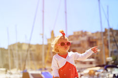 Cute little girl travel in the port Royalty Free Stock Photos