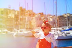 Cute little girl travel in the port Royalty Free Stock Photo