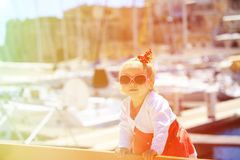 Cute little girl travel in the port Stock Photo